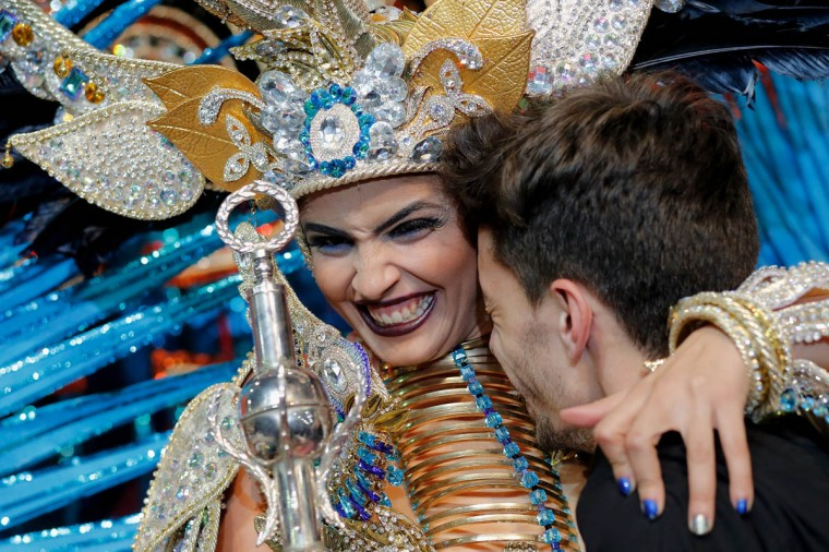 Amanda Perdomo (Left) reacts as she sees designer Daniel Pages (Right) after she was elected Queen of the 2013 Santa Cruz carnival on February 26, 2014 in Santa Cruz de Tenerife on the Canary island of Tenerife, Spain. The Carnival of Santa Cruz de Tenerife brings every year thousands of revellers. Santa Cruz is the closest European equivalent to the Brazilian Carnival from Rio Janeiro. (Pablo Blazquez Dominguez/Getty Images)