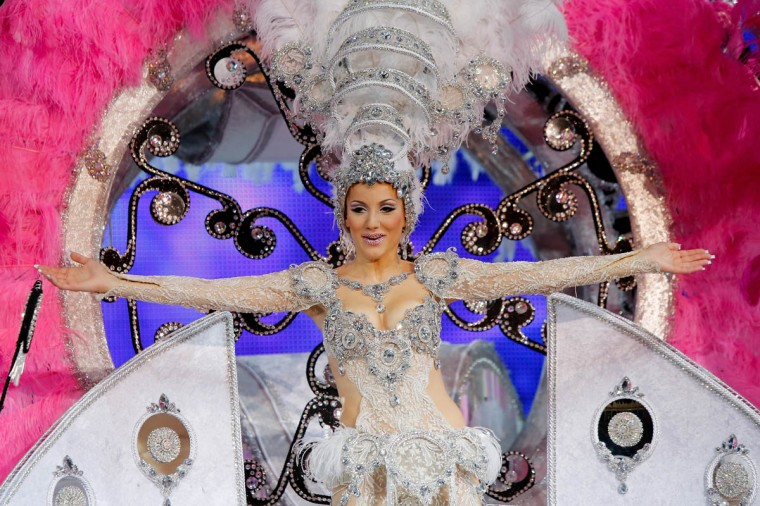 Nominee for Queen of the 2013 Santa Cruz carnival Carmen Desire Garcia performs on February 26, 2014 in Santa Cruz de Tenerife on the Canary island of Tenerife, Spain. The Carnival of Santa Cruz de Tenerife brings every year thousands of revellers. Santa Cruz is the closest European equivalent to the Brazilian Carnival from Rio Janeiro. (Pablo Blazquez Dominguez/Getty Images)