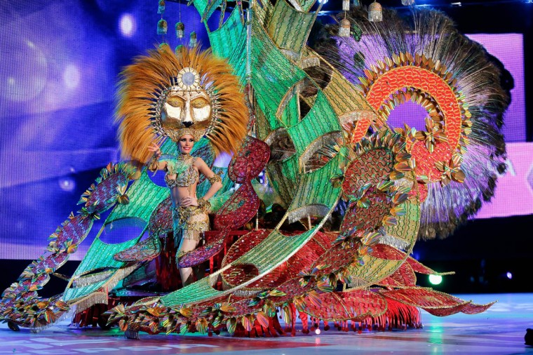 Nominee for Queen of the 2013 Santa Cruz carnival Suleima Martin performs on February 26, 2014 in Santa Cruz de Tenerife on the Canary island of Tenerife, Spain. The Carnival of Santa Cruz de Tenerife brings every year thousands of revellers. Santa Cruz is the closest European equivalent to the Brazilian Carnival from Rio Janeiro. (Pablo Blazquez Dominguez/Getty Images)
