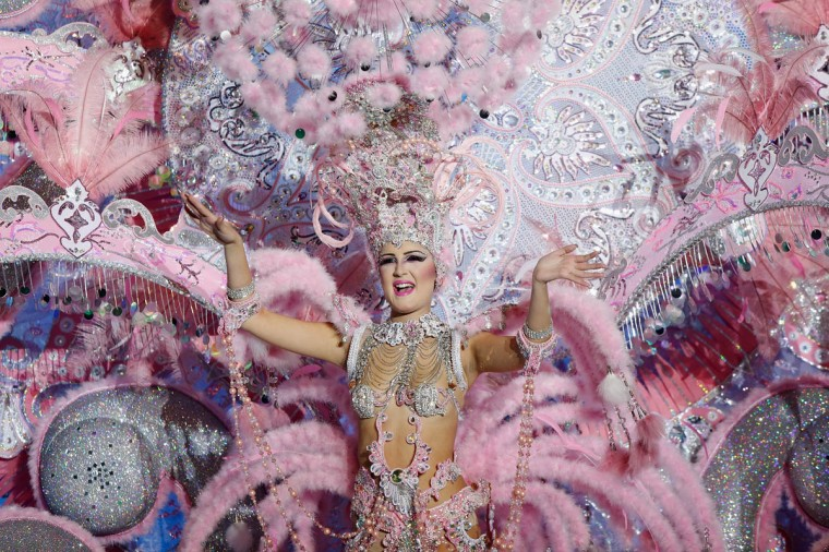 Nominee for Queen of the 2013 Santa Cruz carnival Ariana Mejias performs on February 26, 2014 in Santa Cruz de Tenerife on the Canary island of Tenerife, Spain. The Carnival of Santa Cruz de Tenerife brings every year thousands of revellers. Santa Cruz is the closest European equivalent to the Brazilian Carnival from Rio Janeiro. (Pablo Blazquez Dominguez/Getty Images)