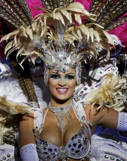 Nominee for Queen of the 2013 Santa Cruz carnival Noemi Hormiga performs on February 26, 2014 in Santa Cruz de Tenerife on the Canary island of Tenerife, Spain. The Carnival of Santa Cruz de Tenerife brings every year thousands of revellers. Santa Cruz is the closest European equivalent to the Brazilian Carnival from Rio Janeiro. (Pablo Blazquez Dominguez/Getty Images)