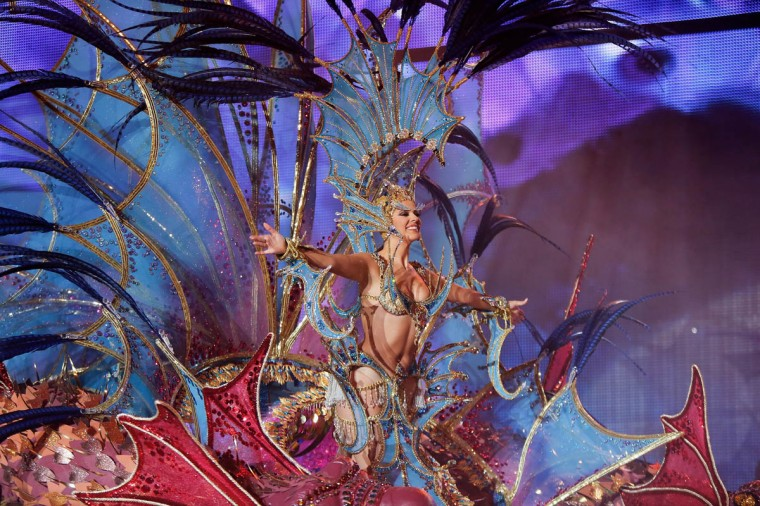 Nominee for Queen of the 2013 Santa Cruz carnival Nuria Garcia performs on February 26, 2014 in Santa Cruz de Tenerife on the Canary island of Tenerife, Spain. The Carnival of Santa Cruz de Tenerife brings every year thousands of revellers. Santa Cruz is the closest European equivalent to the Brazilian Carnival from Rio Janeiro. (Pablo Blazquez Dominguez/Getty Images)