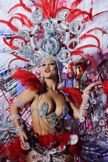 Nominee for Queen of the 2013 Santa Cruz carnival Veronica Gil Perez performs on February 26, 2014 in Santa Cruz de Tenerife on the Canary island of Tenerife, Spain. The Carnival of Santa Cruz de Tenerife brings thousands of revellers every year. Santa Cruz is the closest European equivalent to the Brazilian Carnival from Rio Janeiro. (Pablo Blazquez Dominguez/Getty Images)