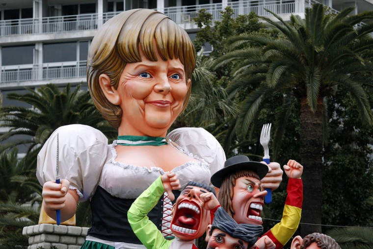 """A float named """"Angela's euro sauerkraut"""" and featuring German Chancellor Angela Merkel parades on February 25, 2014 during the Nice Carnival, southeastern France. The theme of this year's carnival, running from February 14 until March 4, 2014, is the """"King of Gastronomy"""". (Valery Hache/Getty Images)"""