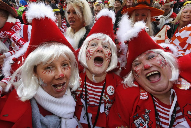"Women dressed in costumes for ""Weiberfastnacht"" (Women's Carnival) celebrate in Cologne February 27, 2014. Women's Carnival marks the start of a week of street festivals, the highlight of the event being ""Rosenmontag"" (Rose Monday), the final day of the carnival where mass processions are held. (Ina Fassbender/Reuters photo)"
