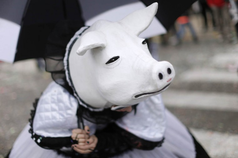 """Dancers parade on February 25, 2014 during the Nice Carnival, southeastern France. The theme of this year's carnival, running from February 14 until March 4, 2014, is the """"King of Gastronomy"""". (Valery Hache/Getty Images)"""