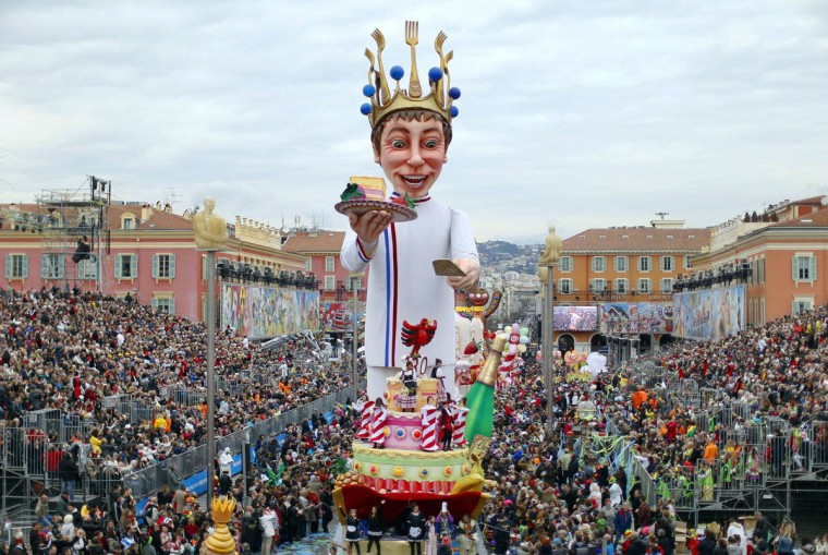 """The """"King"""" float parades during the Nice Carnival on February 25, 2014 in Nice, southeastern France. The theme of this year's carnival, running from February 14 until March 4, 2014, is the """"King of Gastronomy"""". (Valery Hache/Getty Images)"""