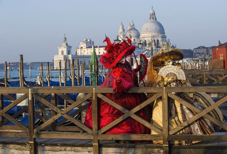 Two women dressed in Carnival Costumes pose in Saint Mark's Square on February 25, 2014 in Venice, Italy. The 2014 Carnival of Venice will run from February 15 to March 4 and includes a program of gala dinners, parades, dances, masked balls and music events. (Marco Secchi/Getty Images)
