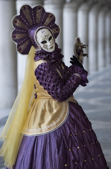 A woman dressed in Carnival Costume poses in Saint Mark's Square on February 25, 2014 in Venice, Italy. The 2014 Carnival of Venice will run from February 15 to March 4 and includes a program of gala dinners, parades, dances, masked balls and music events. (Marco Secchi/Getty Images)