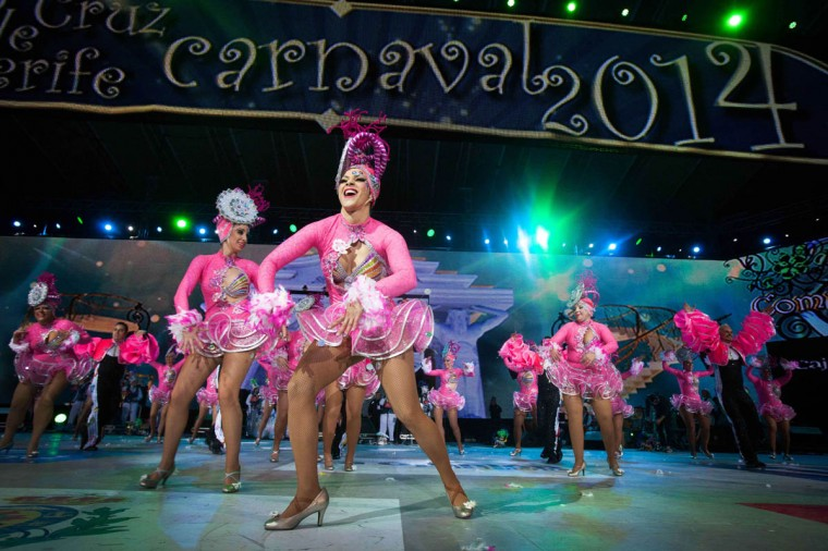 Dancers perform on the main stage in the battle of the troops contest during the carnival in Santa Cruz de Tenerife on the Spanish Canary island of Tenerife on February 22, 2014. The over month long event began on January 31 and finishes on March 8 with orchestras playing Caribbean and Brazilian rhythms throughout the festivities that range from elections for the Carnival Queen, the Junior Queen and the Senior Queen, childrens and adult murgas (satirical street bands), comparsas (dance groups) to performances on the streets. (Desiree Martin/Getty Images)