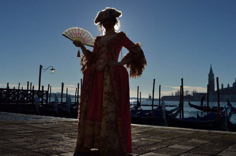 """A costumed reveller poses on St Mark's square during the carnival on February 23, 2014 in Venice. The 2014 edition of the Venice carnival is untitled """" Wonder and fantasy nature"""" and runs from February 15 to March 4, 2014. (Gabriel Bouys/Getty Images)"""
