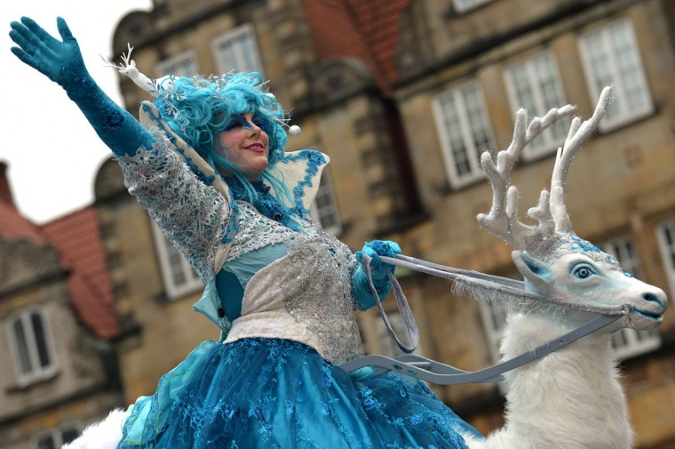 A woman in a colorful costume waves during the carnival parade in Bremen, northwestern Germany, on February 22, 2014. This year's motto of the so-called 'Samba Karneval' is 'Heimat?' (home?). (Michael Bahlo/Getty Images)