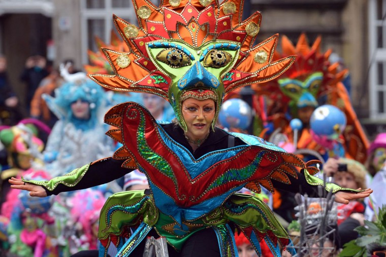 A woman in a colorful costume is pictured during the carnival parade in Bremen, northwestern Germany, on February 22, 2014. This year's motto of the so-called 'Samba Karneval' is 'Heimat?' (home?). (Michael Bahlo/Getty Images)