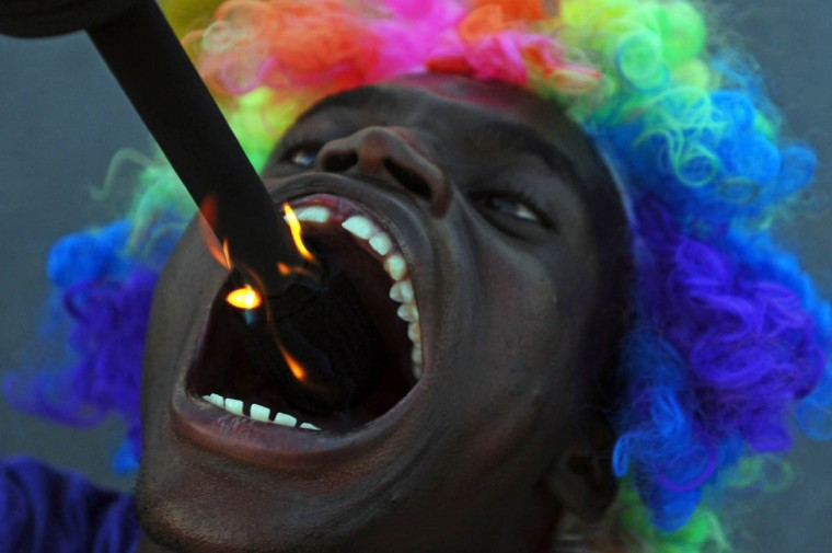 A fire-swallower performs during the Carnival of Delmas, in Port au Prince on February 21, 2014. (Hector Retamal/Getty Images)