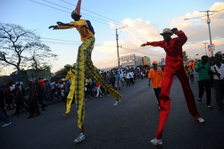 Stilt-walkers perform during the Carnival of Delmas, in Port au Prince on February 21, 2014. (Hector Retamal/Getty Images)
