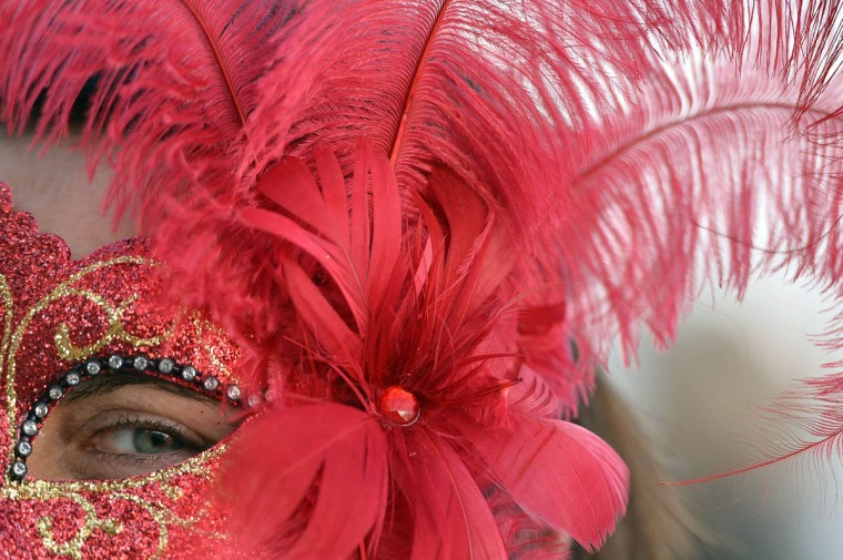 """A costumed reveller poses on Saint Mark's square during the carnival on February 21, 2014 in Venice. The 2014 edition of the Venice carnival is untitled """" Wonder and fantasy nature"""" and runs from February 15 to March 4, 2014. (Gabriel Bouys/Getty Images)"""