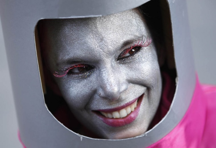 "A woman dressed in a costume for ""Weiberfastnacht"" (Women's Carnival) smiles in Cologne February 27, 2014. Women's Carnival marks the start of a week of street festivals, the highlight of the event being ""Rosenmontag"" (Rose Monday), the final day of the carnival where mass processions are held. (Ina Fassbender/Reuters photo)"