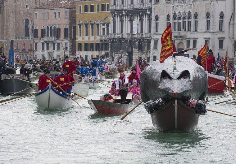 "The ""Pantegana"" (Big Rat) sails on the Grand Canal for the traditional regatta which officially opens the Carnival on February 16, 2014 in Venice, Italy. The 2014 Carnival of Venice will run from February 15 to March 4 and includes a program of gala dinners, parades, dances, masked balls and music events. (Marco Secchi/Getty Images)"