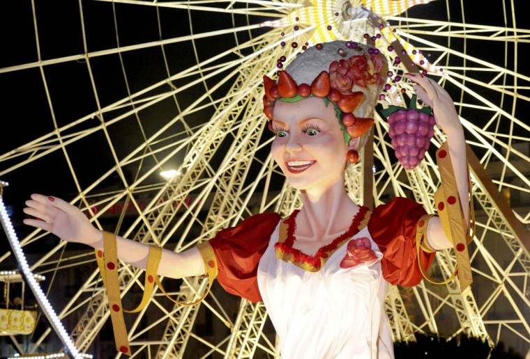 """The Queen of Carnival float makes it way through the crowd during the Carnival parade in Nice February 15, 2014. The 130th Carnival of Nice runs from February 14 to March 4 and celebrates the """"King of Gastronomy"""". (Olivier Anrigo/Reuters photo)"""