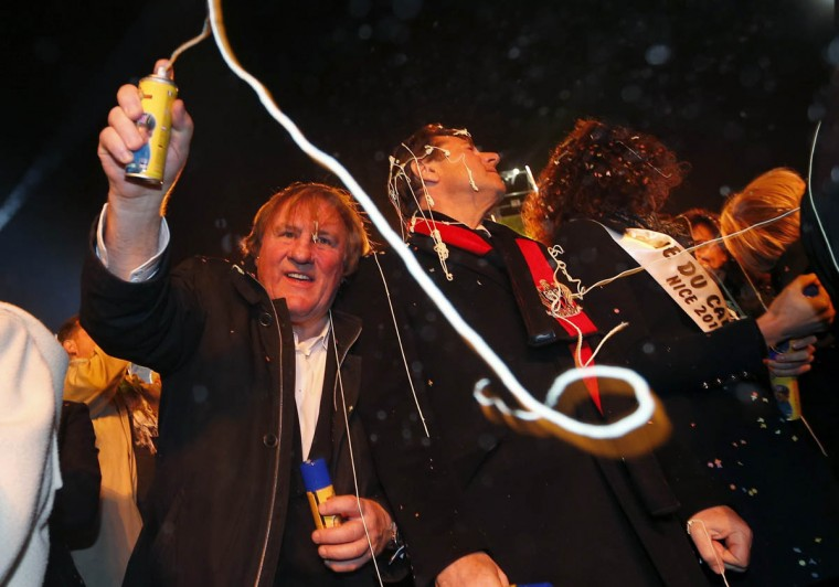 French actor Gerard Depardieu (Left) and Nice's mayor Christian Estrosi attend the Nice Carnival parade on February 14, 2014 in Nice, southeastern France. The Carnival starts on February 14 and will last until March 4, 2014. (Valery Hache/Getty Images)