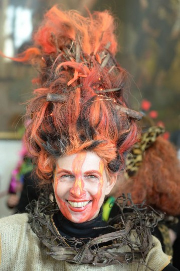 A costumed woman celebrates the street carnival in Duesseldorf, western Germany on February 27, 2014. Germans, mainly in the western Rhine region, crowd the streets to celebrate carnival.(Patrik Stollarz/Getty Images)