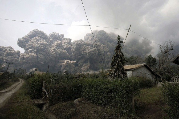 A giant cloud of hot volcanic ash clouds engulfs villages in Karo district during the eruption of Mount Sinabung volcano located in Indonesia's Sumatra island on February 1, 2014. (Chaideer Mahyuddin/AFP/Getty Images)