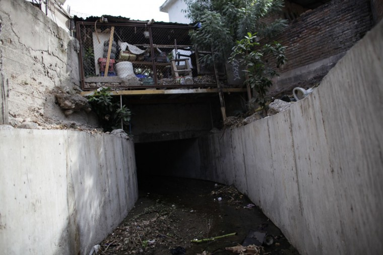 "A drain exit which leads to a tunnel underneath one of the houses of Joaquin ""Chapo""Guzman is seen in a neighborhood in Culiacan February 25, 2014. Guzman, who rose from humble origins to become one of the most powerful drug barons in history, was captured on Friday in Sinaloa. Picture taken February 25, 2014. (REUTERS/Daniel Becerril)"
