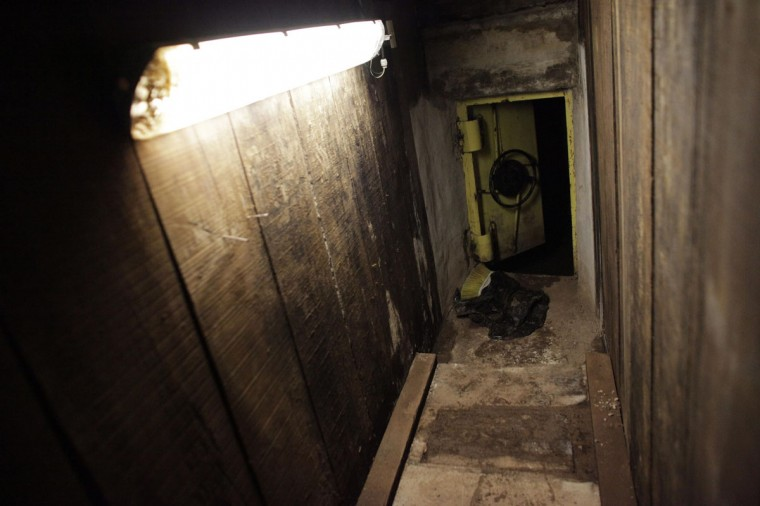 "An open steel door leads from a tunnel underneath one of the houses of Joaquin ""Chapo"" Guzman to the city's drainage system in Culiacan February 25, 2014. (REUTERS/Daniel Becerril)"