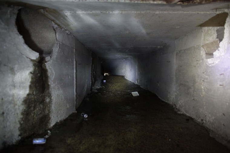 "Part of the city's drainage system which leads to a tunnel underneath one of the houses of Joaquin ""Chapo"" Guzman is seen in Culiacan February 25, 2014. Guzman, who rose from humble origins to become one of the most powerful drug barons in history, was captured on Friday in Sinaloa. Picture taken February 25, 2014. (REUTERS/Daniel Becerril)"