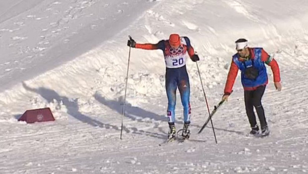 A coach from the Canadian team came to the rescue of a Russian cross-country skier during his men's semifinal of the cross-country sprint at the 2014 Winter Olympics, Tuesday, Feb. 11, 2014, in Krasnaya Polyana, Russia. (NBC screengrab via Deadspin)