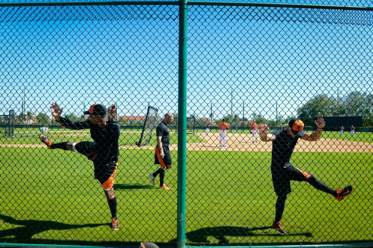The Baltimore Orioles warm up for the first day of Spring Training practice for pitchers and catchers at Ed Smith Stadium in Sarasota, Fla. on Friday, Feb. 14, 2014. (2.14.2014)(Elaine Litherland/Sarasota Herald-Tribune)