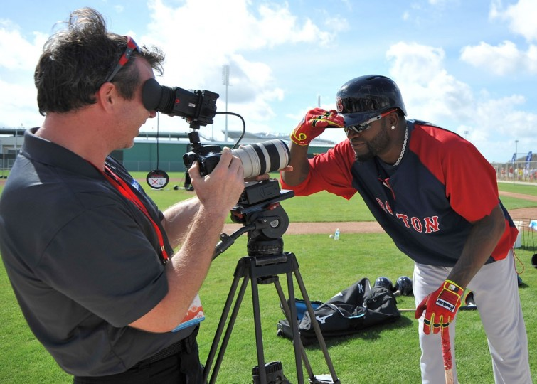 Boston Red Sox designated hitter David Ortiz (34) jokes around with a videographer before batting practice during spring training at JetBlue Park. (Steve Mitchell-USA TODAY Sports)