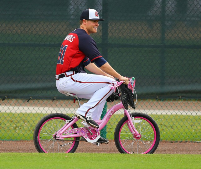 Atlanta Braves pitcher Shae Simmons makes the rounds from drill to drill on a youth bicycle during spring training on Friday, Feb. 21, 2014, in Lake Buena Vista, Fla. (Curtis Compton/Atlanta Journal-Constitution/MCT)