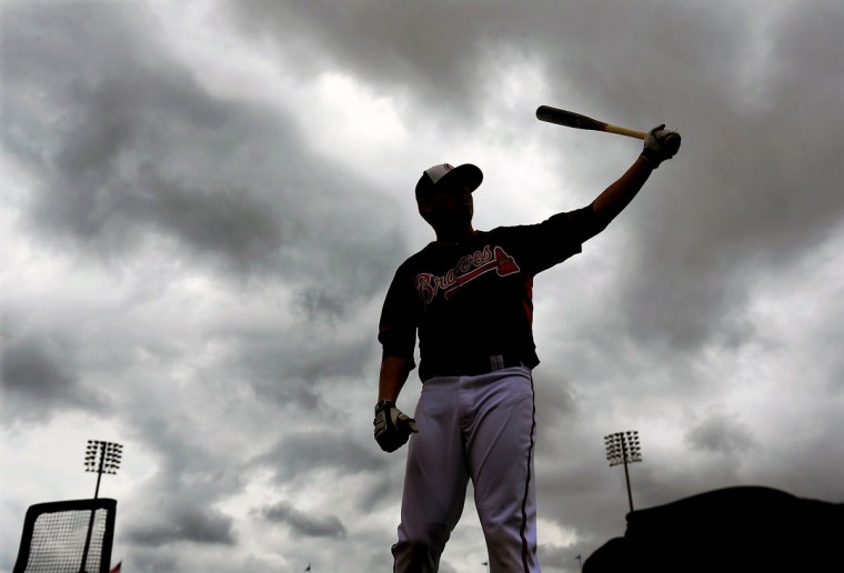 Rain clouds roll in as Atlanta Braves infielder Ramiro Pena loosens up during spring training on Friday, Feb. 21, 2014, in Lake Buena Vista, Fla. (Curtis Compton/Atlanta Journal-Constitution/MCT)