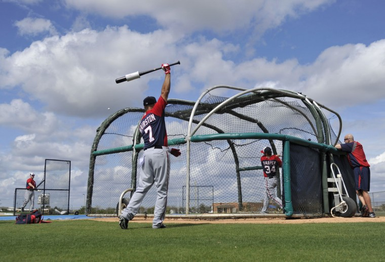 Washington Nationals left fielder Bryce Harper (34) hits as Scott Hairston (7) gets ready during spring training action at space Coast Stadium. (Brad Barr-USA TODAY Sports)