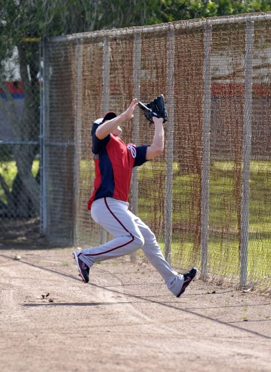 Washington Nationals outfielder Nate McLouth (15) makes a catch at the fence in spring training action at space Coast Stadium. (Brad Barr-USA TODAY Sports)