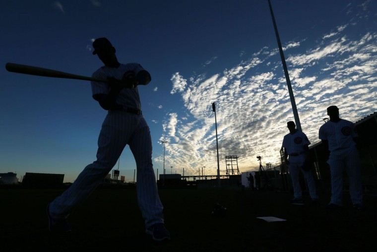 Chicago Cubs outfielder Jorge Soler, left, takes his turn at dawn posing for a baseball card photographer at spring training in Mesa, Ariz., on Monday, Feb. 24 2014. (Chris Walker/Chicago Tribune/MCT)