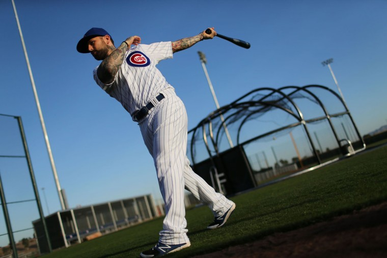 Chicago Cubs infielder Ryan Roberts poses for a baseball card photographer at spring training in Mesa, Ariz., on Monday, Feb. 24 2014. (Chris Walker/Chicago Tribune/MCT)