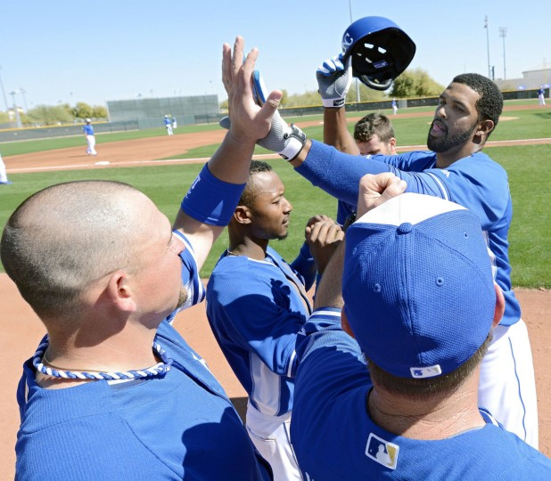 Kansas City Royals Carlos Pguero is congratulated after hitting a home run during an intrasquad spring training game in Surprise, Ariz., on Monday, Feb. 24, 2014. (John Sleezer/Kansas City Star/MCT)