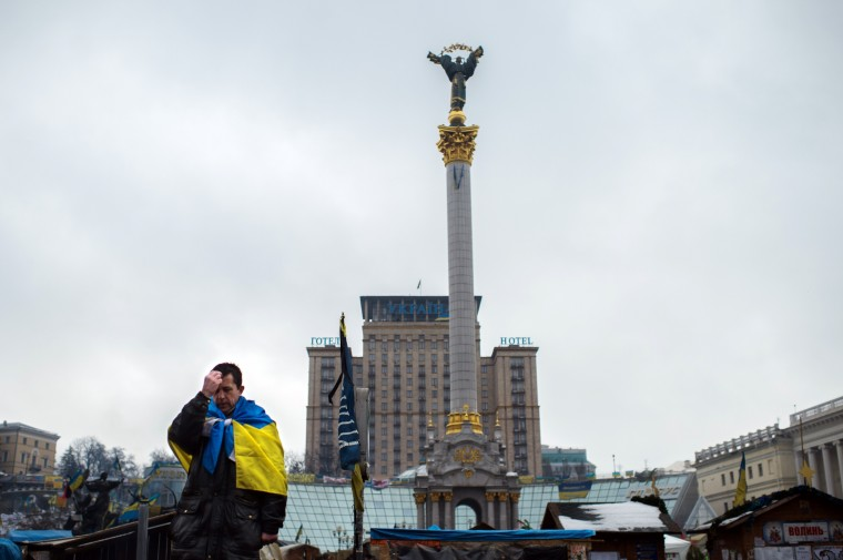 A man prays on Kiev's Independence Square on February 7, 2014. Ukraine's embattled president, Viktor Yanukovych, flew to Sochi late Thursday for crisis talks with Russian counterpart Vladimir Putin on the sidelines of the opening ceremony for the Winter Olympics. (Martin Bureau/AFP/Getty Images)