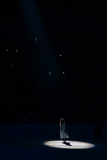 A young girl performs during the Opening Ceremony of the Sochi Winter Olympics at the Fisht Olympic Stadium on February 7, 2014 in Sochi. (Andrej Isakovic/AFP/Getty Images)