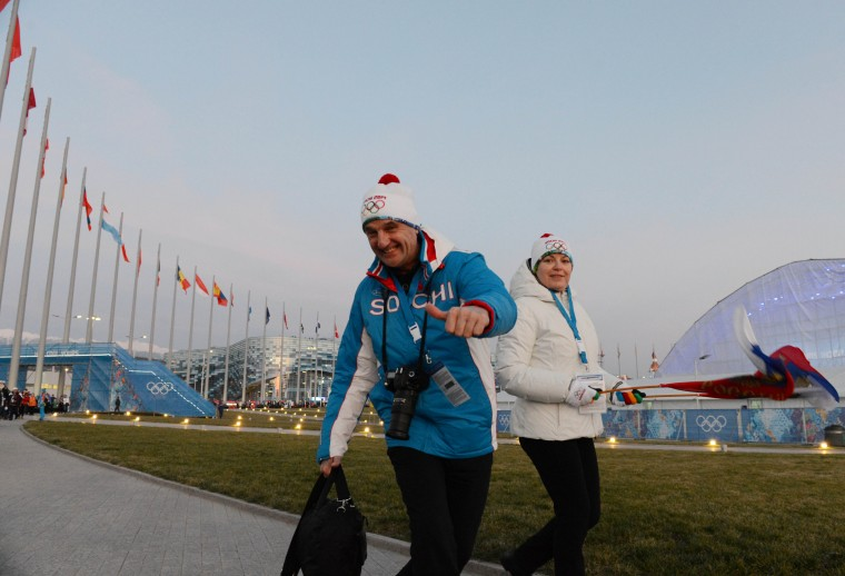 Fans walk in Olympic Park prior to the opening ceremony for the Sochi 2014 Olympic Winter Games at Fisht Olympic Stadium. (Jayne Kamin-Oncea/USA TODAY Sports)