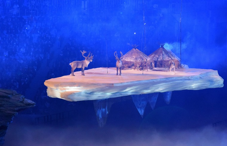 Reindeer stand near gurs as a Russian rural landscape scene floats past during the Opening Ceremony of the Sochi Winter Olympics at the Fisht Olympic Stadium on February 7, 2014 in Sochi. (Damien Meyer/AFP/Getty Images)