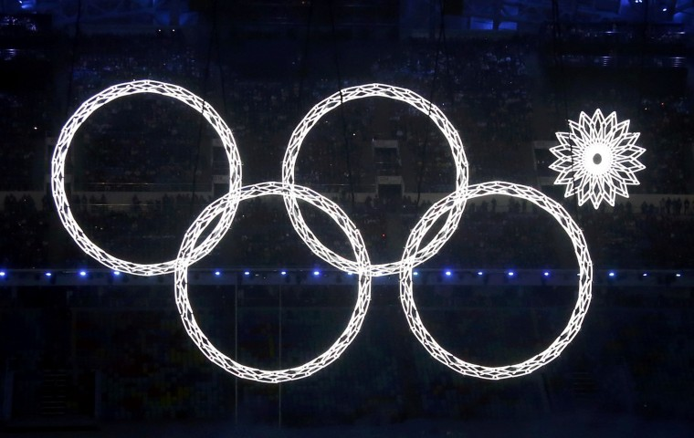 Four of five Olympic Rings are seen lit up during the opening ceremony of the 2014 Sochi Winter Olympics, February 7, 2014. (REUTERS/Lucy Nicholson)