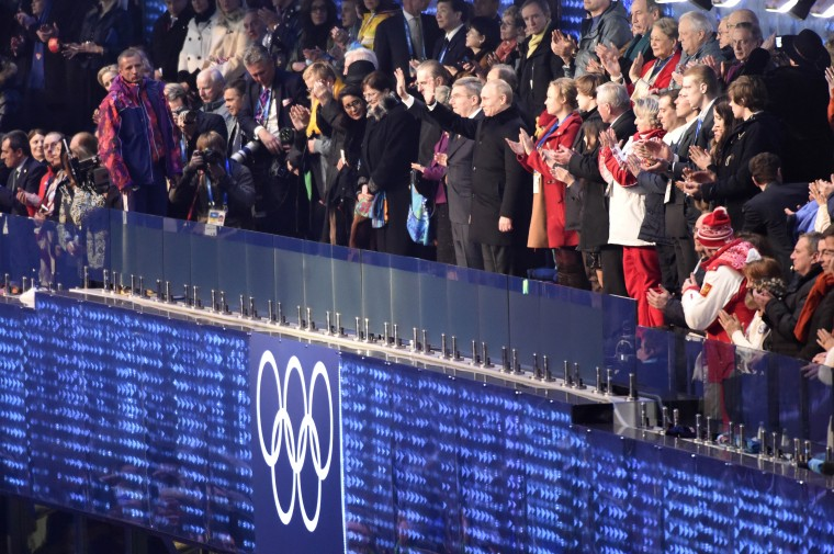 Russian Federation president Vladimir Putin waves to the crowd during the opening ceremony for the Sochi 2014 Olympic Winter Games at Fisht Olympic Stadium. (Robert Hanashiro/USA TODAY Sports)
