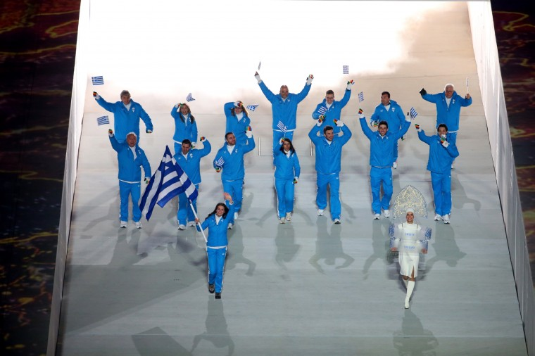 Cross country skier Panagiota Tsakiri of the Greece Olympic team carries her country's flag during the Opening Ceremony of the Sochi 2014 Winter Olympics at Fisht Olympic Stadium on February 7, 2014 in Sochi, Russia. (Photo by Quinn Rooney/Getty Images)