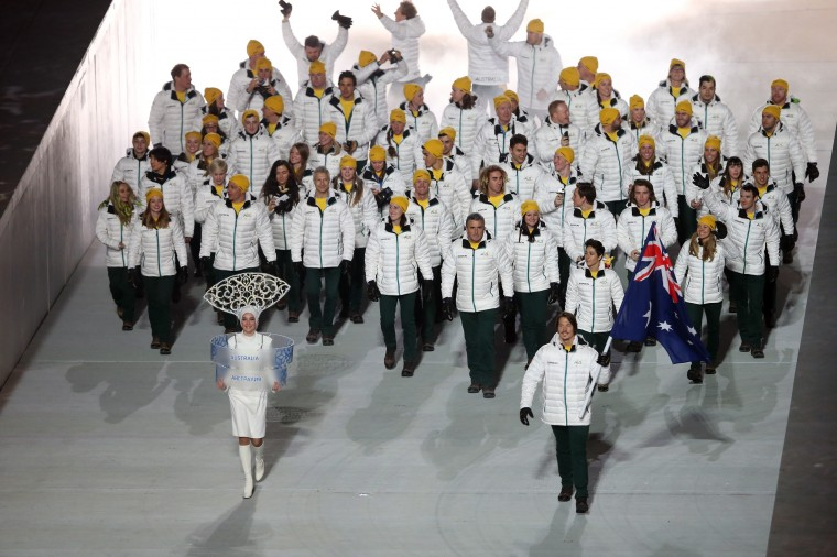 Snowboarder Alex Pullin of the Australia Olympic team carries his country's flag during the Opening Ceremony of the Sochi 2014 Winter Olympics at Fisht Olympic Stadium on February 7, 2014 in Sochi, Russia. (Photo by Bruce Bennett/Getty Images)