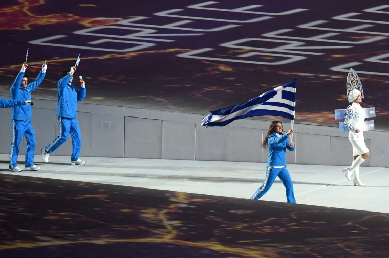 Greece's flag bearer, cross-country skier Panagiota Tsakiri enters the stadium during the Opening Ceremony of the Sochi Winter Olympics at the Fisht Olympic Stadium on February 7, 2014 in Sochi. (Damien Meyer/AFP/Getty Images)