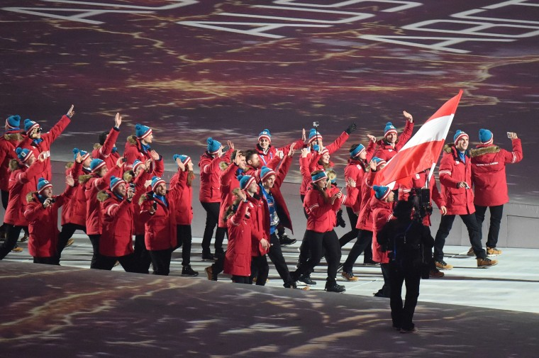 The Austrian dlegation enters the stadium led by flag bearer, nordic combined skier Mario Stecher during the Opening Ceremony of the Sochi Winter Olympics at the Fisht Olympic Stadium on February 7, 2014 in Sochi. (Damien Meyer/AFP/Getty Images)