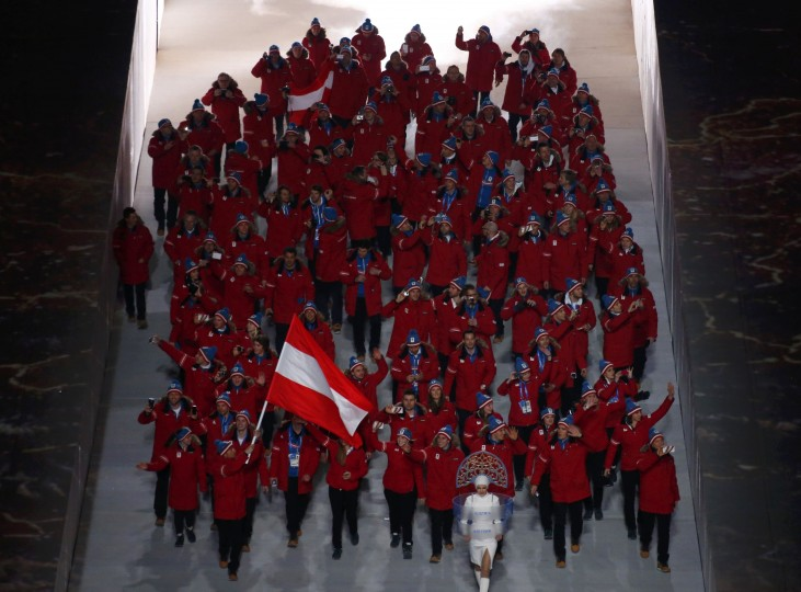 Austria's flag-bearer Mario Stecher leads his country's contingent during the opening ceremony of the 2014 Sochi Winter Olympics, February 7, 2014. (REUTERS/David Gray)